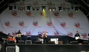 Full band stage shot from F1 at Silverstone. Fender strat guitar, fender baseman amp, gigrig pro midi 14 pedal, zen drive.